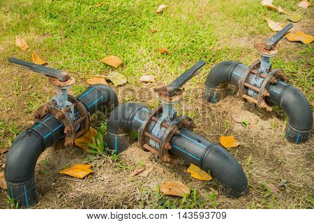 Water control valve on field grass HDPE pipeline.