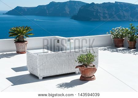 Beautiful terrace in Santorini with view on the volcano - Greece