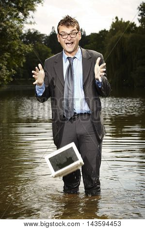 Crazy businessman in suit dropped notebook to water