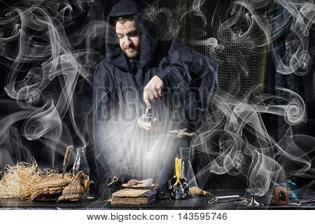 Portrait Of A Crazy Medieval Scientist Working In His Laboratory.