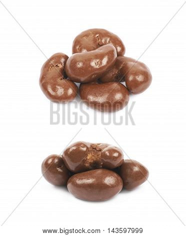 Pile of multiple chocolate coated cashew nuts isolated over the white background, set of two different foreshortenings