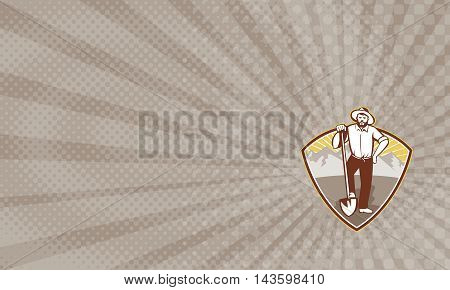 Business card showing illustration of a gold digger miner prospector with shovel spade done in retro style set inside shield with mountains in background.