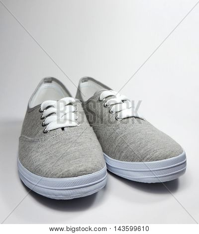 Gray shoes or sneakers, studio shot with copy space.