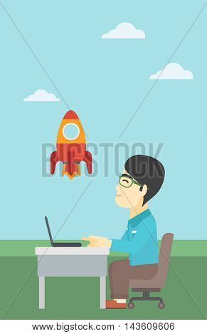 An asian young businessman sitting at the table and looking at a flying rocket. Businessman working on a laptop. Business start up concept. Vector flat design illustration. Vertical layout.