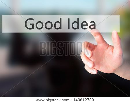 Good Idea - Hand Pressing A Button On Blurred Background Concept On Visual Screen.