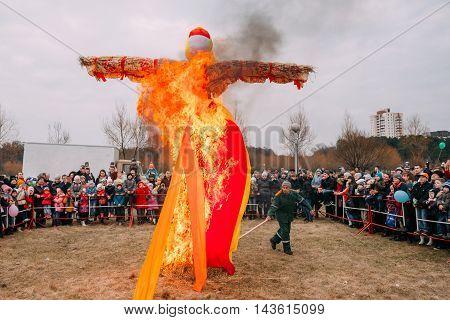 Gomel, Belarus  - March 12, 2016: The Scene Of Ignition Dummy Symbolizing  Winter And Death In Slavic Mythology, Pagan Tradition. The Oldest Surviving Eastern Slavic Religious, Folk Holiday Maslenitsa
