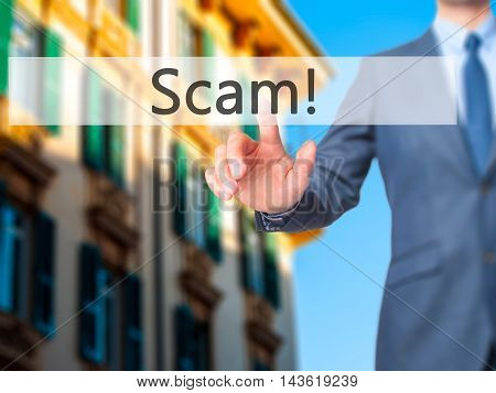 Scam! - Businessman Hand Pressing Button On Touch Screen Interface.