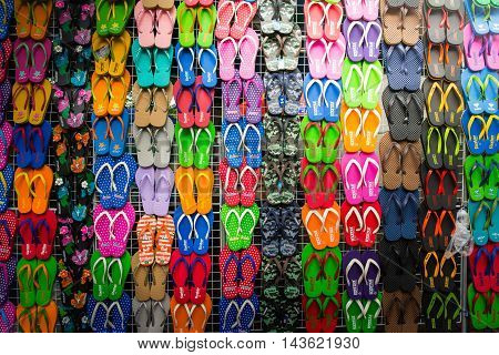 BANGKOK, THAILAND - AUGUST, 2016 - Colorful slippers are displayed on trellises for sale in Jatujak weekend market. Jatujak market is the largest flea market in the world located in Bangkok, Thailand.