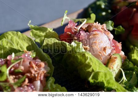 Lettuce tacos with tuna and kingfish on a plate