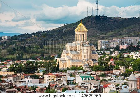 View Of Sameba Or Holy Trinity Cathedral Of Tbilisi, The Main Georgian Orthodox Church Erected On The Elia Hill Nowadays, The Colorful Buildings Of Summer Elia Neighborhood Around. Georgia