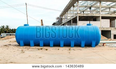 Blue plastic water tank outdoors waste water