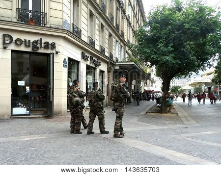 PARIS FRANCE - AUGUST 11 2016: Soldiers patrol the city streets. Terror threat international terrorism.