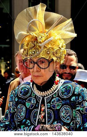 New York City - April 20 2014: The legendary Rollarena sporting an inventive bonnet at the Easter Parade on Fifth Avenue