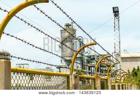 Barbed wire backdrop petroleum industry Rayong in Thailand.