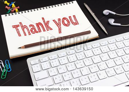 Word text Thank you on white paper on office table / business concept