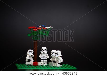 Orvieto Italy - November 15th 2015: Group of Star Wars Lego Stormtroopers minifigures under a tree. Lego is a popular line of construction toys manufactured by the Lego Group