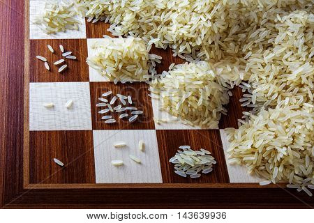 chessboard with exponential growing heaps of rice grains concept of unlimited growth