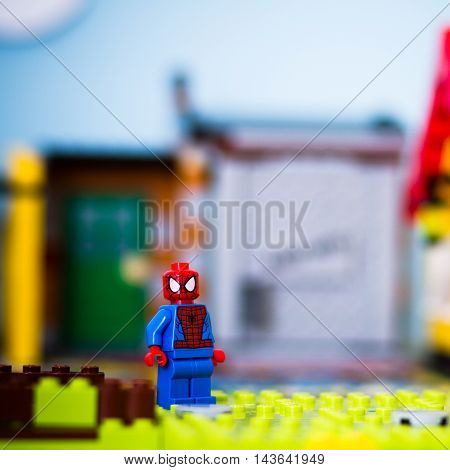 Orvieto Italy - November 15th 2015: Portritrait of Lego Spiderman Minifigures. City and people in background.
