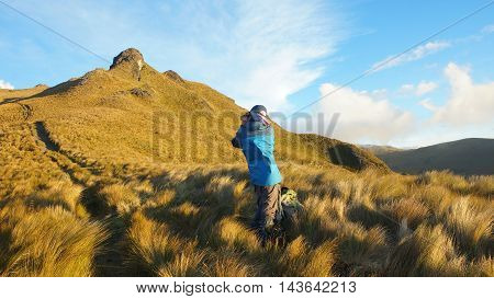 Hiker taking photo on the way to the El Puntas peaks near of the city of Quito / Ecuador