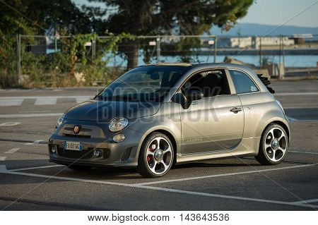 TriesteItaly July 27 2016: Photo of a Abarth 595 Competizione Cabrio.The 595 differs substantially from the Tourism for the aggressive appearance and a few deliberately exaggerations of the sporty character.