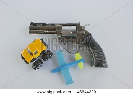 Pistol Revolver Handgun Isolated On White Background. car and a plane.