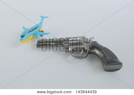 Pistol Revolver Handgun and a plane Isolated On White Background.