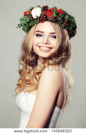 Christmas beautiful Woman with flowers Smiling. Beauty Portrait