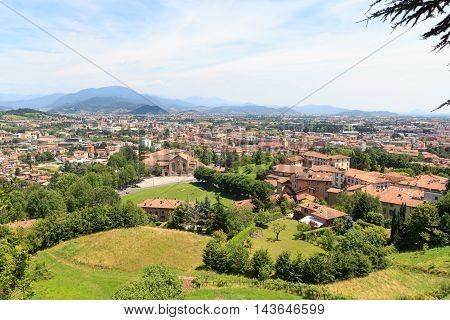 Bergamo Cityscape Panorama With Mountains Seen From Citta Alta, Italy