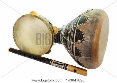 Traditional musical instument Djembe drum tambourine and flute isolated on white background