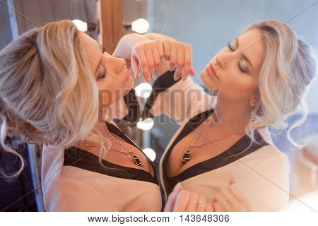 Beauty luxury blonde woman with and mirror