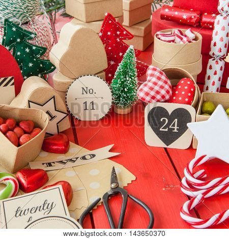 Advent calender with gift bags and boxes filled with candy
