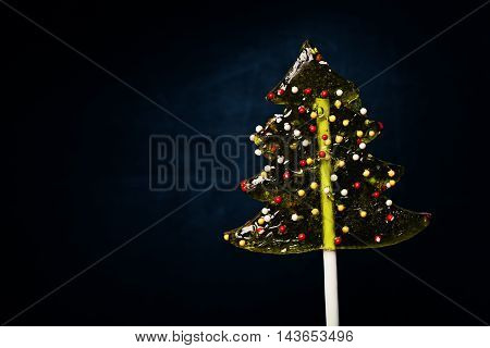 Christmas Background with tasty Xmas Tree Lollipop