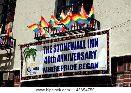 New York City - July 18 2009: Sign and rainbow flags outside legendary Stonewall Inn where the gay liberation movement began in June 1969