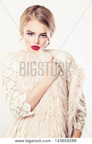 Blonde Woman Fashion Model in Fur Jacket