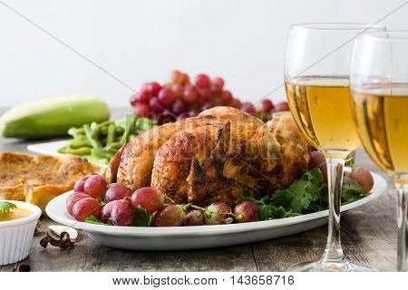 Thanksgiving dinner on rustic wooden table background