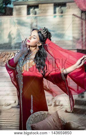 beautiful slim woman arabian turkish oriental artist in carnival costume