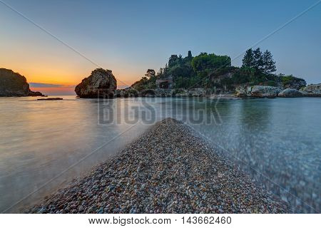 The small Isola Bella in Taormina, Sicily, just before sunrise