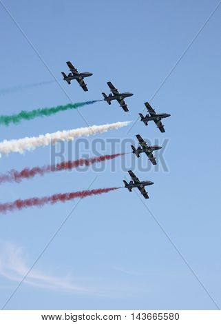 ROME - JUNE 3: The italian acrobatic team Frecce Tricolori perform at the Rome International Air Show on June 3 2012 in Rome Italy