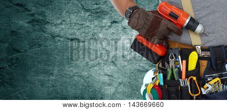 Electrician with drill.
