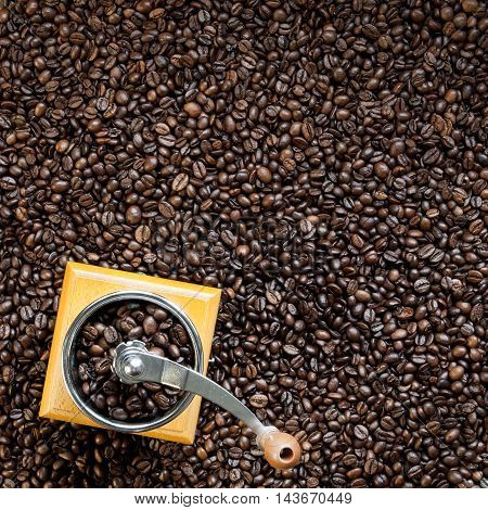 Roasted coffee beans and manual coffee grinder