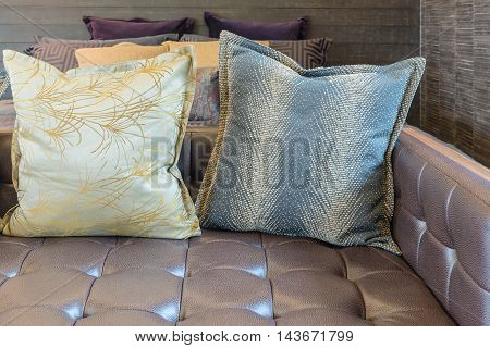 Set Of Pillows On Sofa In Modern Bedroom