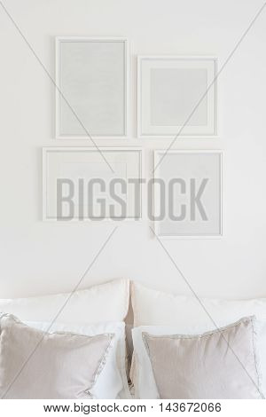 White Blank Picture Frames Hanging On White