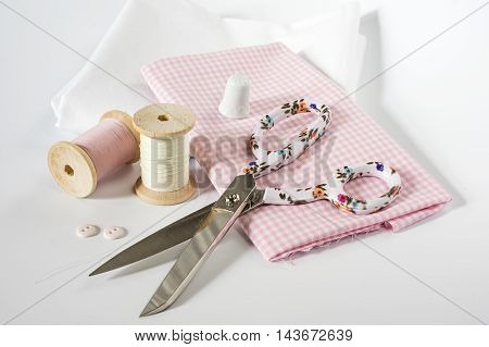 Fabrics, threads and other sewing Utensils on white