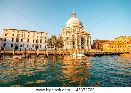 Beautiful waterfront with gothic buildings and Santa Maria basilica on the Grand canal at the morning in Venice