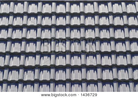 the roof of a house with blue tiles poster