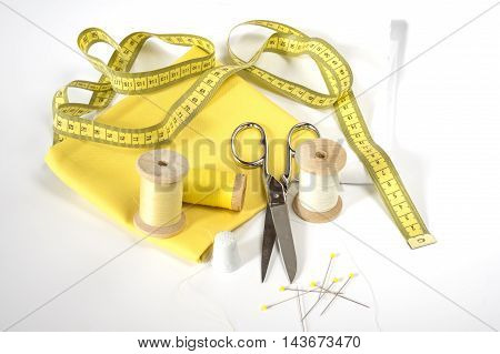Sewing accessories and yellow and White fabric