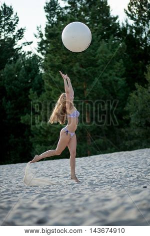 Girl With A Ball On The Beach