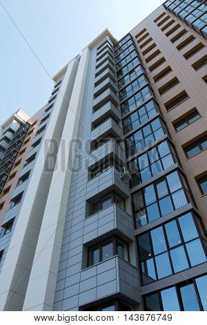 multistorey apartment building on the sky background