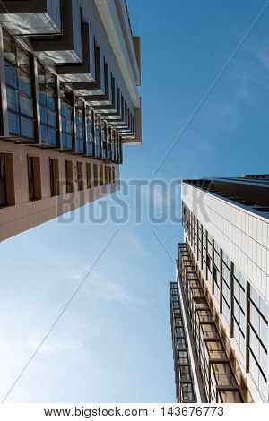 multi-storey high-rise apartment building on the sky background