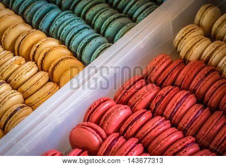 Colourful sweet macarons mini cakes for sale at the Borough Market in London, UK